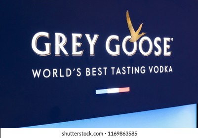 LONDON, UK - AUGUST 31, 2018: Grey goose vodka display board with logo and bottles in store.