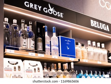 LONDON, UK - AUGUST 31, 2018: Grey goose and Beluga vodka display board with logo and bottles in store.