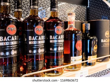 LONDON, UK - AUGUST 31, 2018: Bacardi rum bottles on the shelf in liquor store with prices.