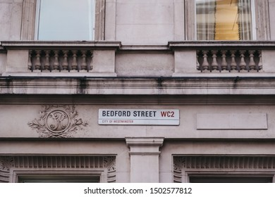 London, UK - August 31, 2019: Street name sign on a wall in Bedford Street, City of Westminster, a borough that occupies much of the central area of London including most of the West End.