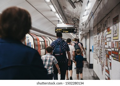 London, UK - August 31, 2019:People walking on Tottenham Court Road London Underground station platform, motion blur, selective focus. London Underground is the oldest underground railway in the world