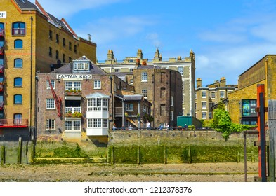London, UK - August 4, 2015: View to the shore development of the Thames at ebb tide in London, UK