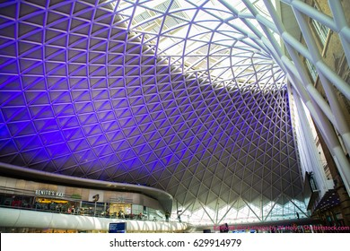 LONDON UK - AUGUST 4,2017. King's Cross railway station western departures concourse diagrid roof structure on August 4, 2017, designed by John McAsian and built by Vinci; located in London, UK.