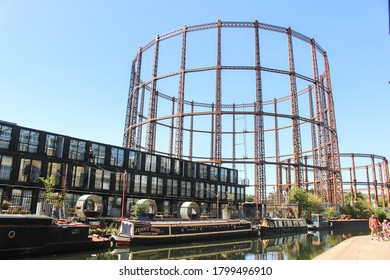 London / UK - August 7 2020: Regent's Canal Walk in East London featuring a gas storage tank near Victoria Park and Broadway Market