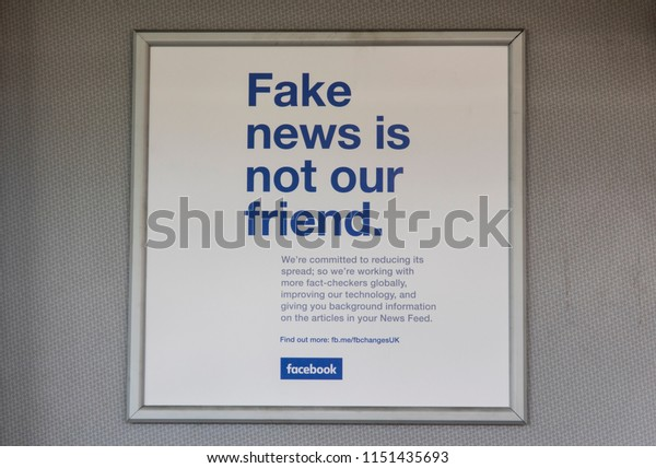 LONDON, UK - AUGUST 7th 2018: Facebook fake news advert. Facebook announcement to reduce fake news stories on the social media website