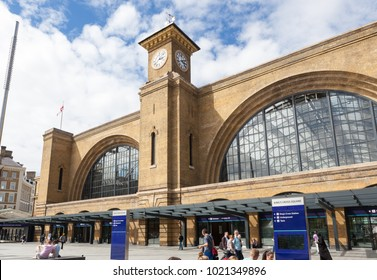 LONDON, UK - AUGUST 9, 2015: Kings Cross Railway Station London with people outside.