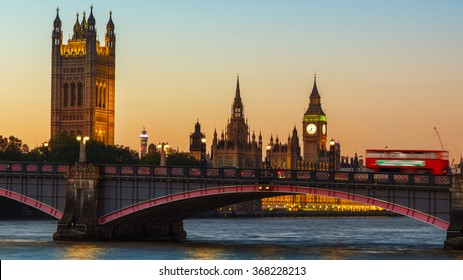 London, UK Big Ben, Houses of Parliament and Red bus on Lambeth Bridge at dusk.