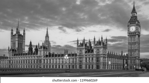 London, UK - Black and White panoramic view of the Houses of Parliament, Palace of Westminster and Westminster Bridge. No people, nobody. Early morning. Cloudy dramatic sky. b&w