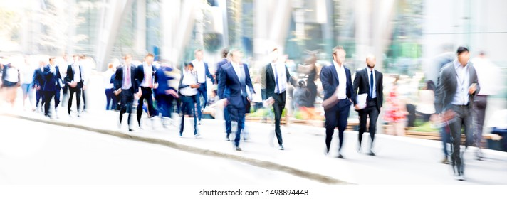 London, UK. Business people walking in the City of London. Beautiful blurred wide background representing busy life and modern business rhythm