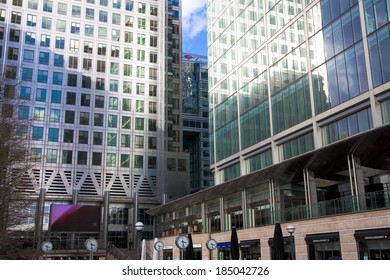LONDON, UK - CANARY WHARF, MARCH 22, 2014: Modern glass buildings of the biggest business district in London. Headquarters for main world's banks, insurance, media companies etc