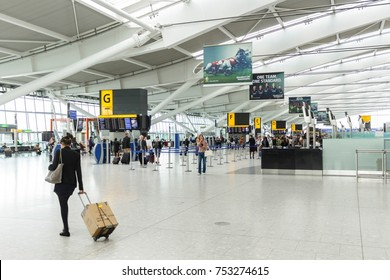 LONDON, UK - CIRCA 2017: A female passenger arrives for checkin at the departure hall in Terminal 5, Heathrow Airport