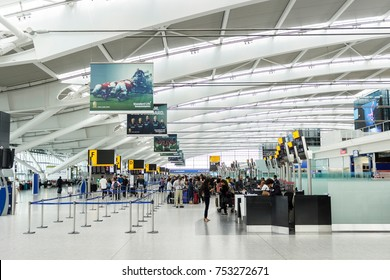 LONDON, UK - CIRCA 2017: Passengers queue for check in at the departure hall in Terminal 5, Heathrow Airport