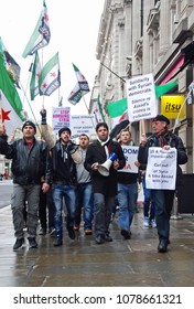 London, UK. Circa 2017. Well known LBGT and human rights campaigner Peter Thatchell leads a small group of placard carrying Syrian democrat protestors on an anti-Assad march.