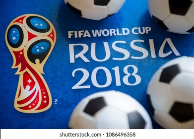 London, UK - CIRCA APRIL 2018: Close-up abstract shot of World Cup ticket envelope framed by mini-footballs.