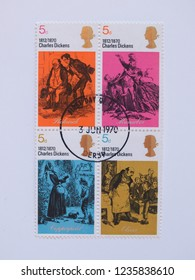 LONDON, UK - CIRCA DECEMBER 2013: British stamps celebrating English writer Charles Dickens dating back to 1970 and worth 5d (5 shillings)