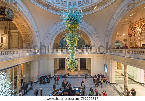 LONDON, UK - CIRCA JANUARY, 2018: Victoria and Albert Museum hall. V&A Museum is the world's largest museum of decorative arts. In 2000, an 11-metre high, blown glass chandelier by Dale Chihuly.