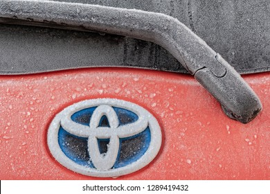 London, UK - Circa January 2019: Detailed view of the rear of a popular, Japanese made hybrid car showing the heavily frosted rear window. The frosted logo and rear window wiper blade can be seen.