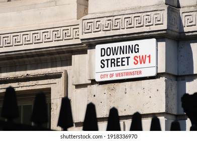 LONDON, UK - CIRCA JULT 2012: Downing Street sign. Downing Street is a street in central London that houses the official residences and offices of the Prime Minister of the UK.