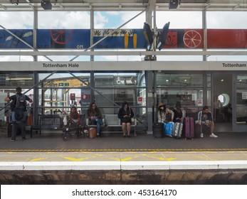 LONDON, UK - CIRCA JUNE 2016: People waiting for transport at Tottenham Hale station platform
