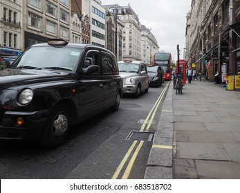 LONDON, UK - CIRCA JUNE 2017: Taxi cabs in the city centre