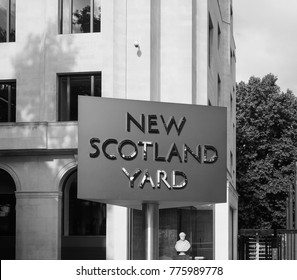 LONDON, UK - CIRCA JUNE 2017: New Scotland Yard metropolitan police service rotating sign in black and white