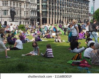 LONDON, UK - CIRCA JUNE 2018: Women suffrage at 100. Women march across London to the Parliament Square to celebrate the centenary of female voting.