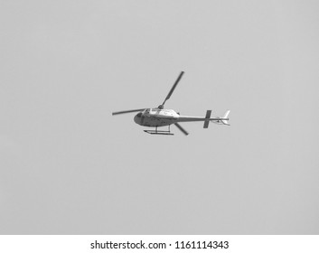 LONDON, UK - CIRCA JUNE 2018: Carabao Thai energy drink helicopter in black and white