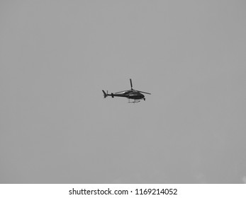 LONDON, UK - CIRCA JUNE 2018: BBC News helicopter hovering over London city centre to film live event in black and white