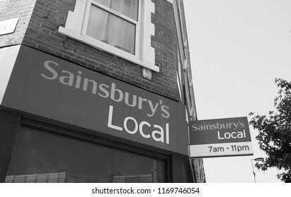 LONDON, UK - CIRCA JUNE 2018: Sainsbury supermarket storefront in black and white