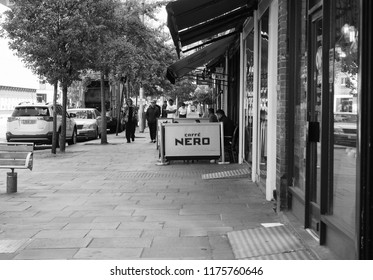 LONDON, UK - CIRCA JUNE 2018: Caffe Nero Italian bar in black and white