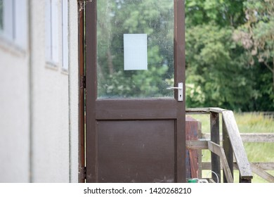 London, UK - Circa June 2019: Shallow focus of an opened office door seen on a temporary office building at an outdoor location. The building is made of wood and fibre and used as a work place.