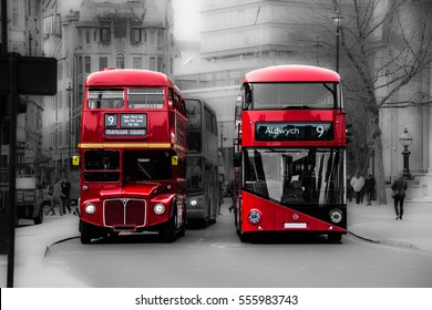 LONDON, UK - CIRCA MARCH, 2014: Two London red buses, one old and one new, stop at traffic lights in Trafalgar Square. Trafalgar Square is a public square in the City of Westminster, Central London.