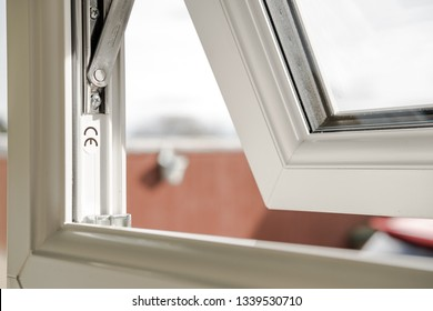 London, UK - Circa March 2019: Shallow focus of CE marking seen within newly installed double glazed windows. The mechanism for the small window can be seen, which is located at the back of the house.