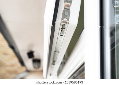London, UK - Circa March 2019: Shallow focus of a new double glazing window system at the back of a house. Details of the new security bolt system and latching is seen in the opened window.