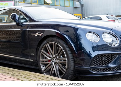 London, UK - Circa March 2019: Isolated view of a newly delivered, British built, ionic two door sports car. Showing the large wheel, composite brake and deep lustre of the paintwork.