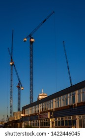 London U.K. Circa March 2019 Giant cranes almost touch the sky in this new housing development in North Acton.Nearby HS2 rail link is being constructed in this re energised are of N.W.London