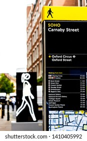 London U.K. Circa May 2019 Street signs in Carnaby Street are clear both analogue and digital.Walk this way, to many points of interest, are illustrated by clear signage and maps so you never get lost
