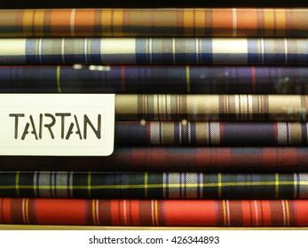 LONDON, UK - CIRCA NOVEMBER 2009: tartan fabric piled in a store for sale
