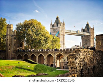 LONDON, UK - CIRCA OCTOBER 2018: London's 19th century Tower Bridge is viewed from within the Tower of London. Historic fortress and castle complex located on the North Bank of the River Thames.