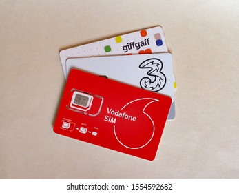 LONDON, UK - CIRCA OCTOBER 2019: Vodafone, Three and Giffgaff mini micro and nano sim cards for mobile telephone