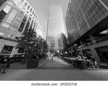 LONDON, UK - CIRCA SEPTEMBER 2015: The Canary Wharf business centre is the largest business district in the United Kingdom - wide angle in black and white
