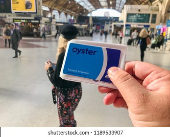 London, UK - Circa September, 2018: Man holding the Oyster Card for pay-as-you-go transaction for all public transport in London.