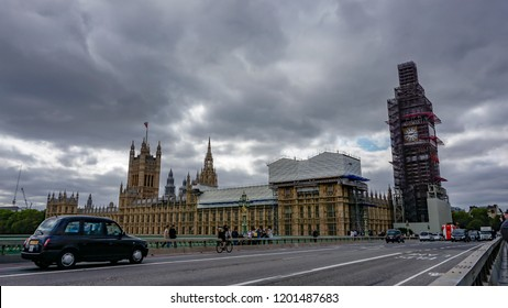 London, UK - Circa September, 2018: Modern London Black Cab at the Westminster Bridge with Big Ben at the background.