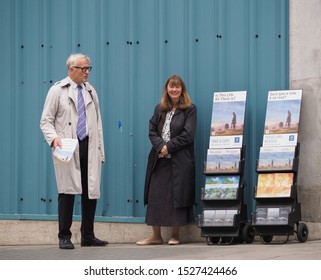 LONDON, UK - CIRCA SEPTEMBER 2019: Jehova's Witnesses distributing copies of The Watchtower