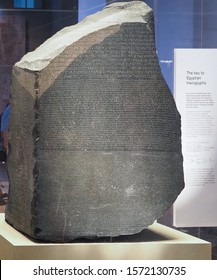 LONDON, UK - CIRCA SEPTEMBER 2019: Rosetta Stone stele at the British Museum with text in Ancient Egyptian hieroglyphic, Demotic scripts and Ancient Greek