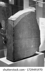 LONDON, UK - CIRCA SEPTEMBER 2019: Rosetta Stone stele at the British Museum with text in Ancient Egyptian hieroglyphic, Demotic scripts and Ancient Greek in black and white