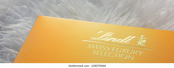 LONDON, UK - DEC 13TH 2017: A box of Lindor by the Lindt company, on 18th December 2017. Chocoladefabriken Lindt & Sprungli AG, commonly known as Lindt, is a Swiss chocolatier.