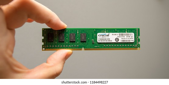 LONDON, UK - DEC 29, 2018: Man holding in hand new powerful RAM manufactured by Crucial by Micron for powerful servers and workstations in data centers