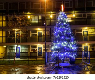 London UK Dec 3 2017 - Christmas tree lit up in blue in the Churchill Estate in Pimlico creating a festive atmosphere