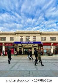 LONDON , UK - DEC 3 2019: People walk passed the old entrance to Farringdon London Underground Station